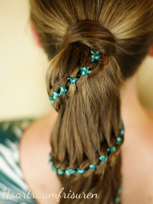 Green ribbon in four strand braid