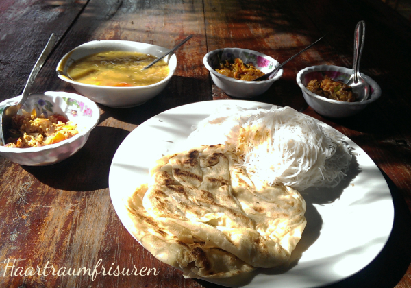 Breakfast with rotis, string hoppers and currys
